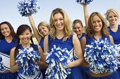 foto of pom poms  - Group portrait of young cheerleaders holding pom - JPG