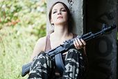 stock photo of ak 47  - Young woman with rifle  - JPG