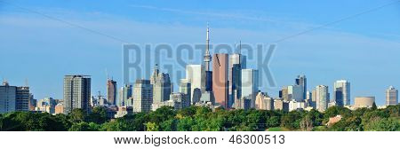 Toronto skyline over park with urban buildings and blue sky