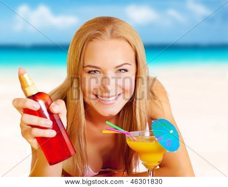Closeup portrait of happy attractive woman with sunscreen and tasty cocktail having fun on the beach, relaxation on seashore, summer vacation concept
