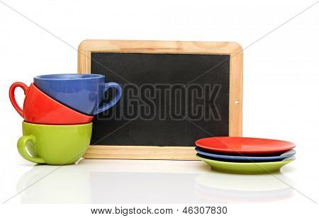 Set of colorful cups with blackboard on white. tea time