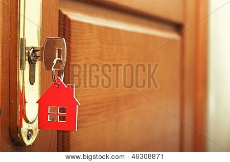 Picture or Photo of A key in a lock with house icon on i.