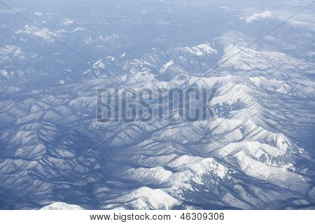 Snowcovered Mountain Range, Japan. Aerial View