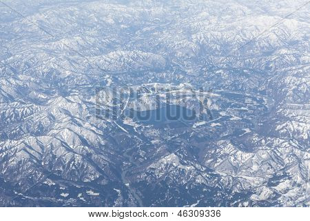 Mountain Lake In The Middle Of Snowcovered Range, Japan. Aerial View