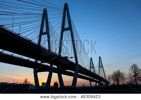 Black Silhouette Of Suspended Bridge During Sunrise On Blue Sky