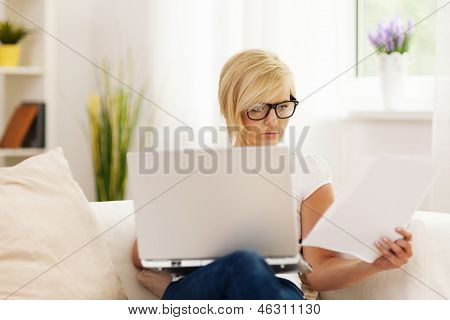 Beautiful woman working at home