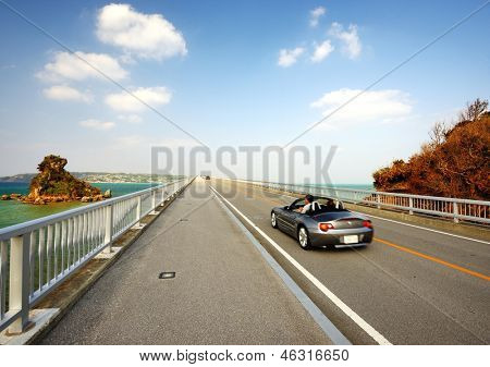 OKINAWA JAPAN - NOVEMBER 14: Vehicular traffic passes over Kurima Bridge November 14, 2012 in Okinawa, JP. It is Considered the longest farm road bridge in Japan at a lenght of 1,690 meters.