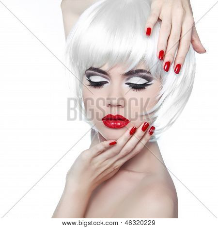 Makeup And Hairstyle. Red Lips And Manicured Nails. Fashion Beauty Girl Isolated On White Background