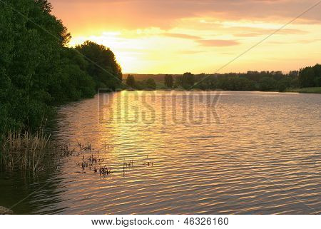 Sunset on forest lake