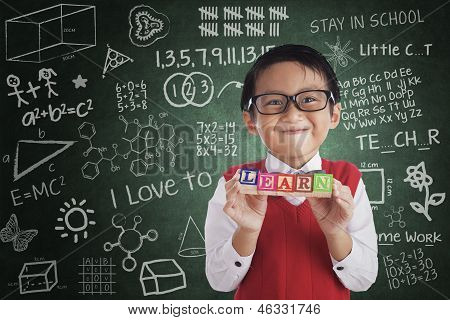 Boy Smiling Hold Learn Crossword In Class