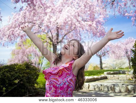 Young Girl Taking A Deep Breath Enjoying Freedom
