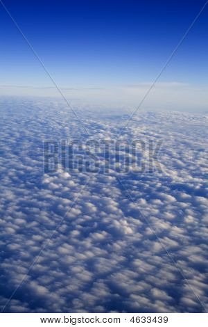 Deep Blue Sky And High Clouds Photographed From Stratosphere (vertical View)