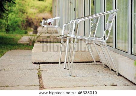 Alumina Folding Chairs On Garden Patios