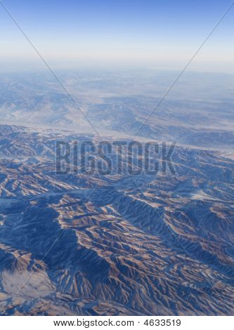 Sunrise In Mountains From Stratosphere At Sunny Day