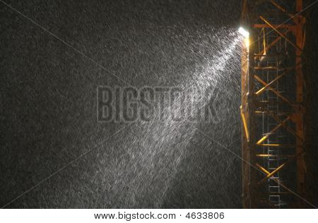 Snowfall In Beam Of Projector At Night