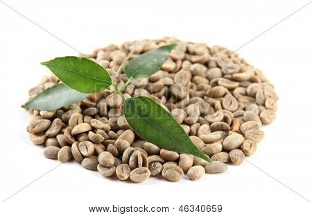 Green coffee beans and leaves isolated on white