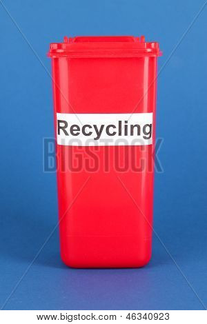 Recycling bin on blue background