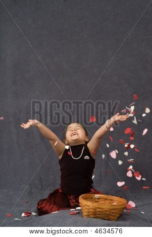 Child Throwing Confetti