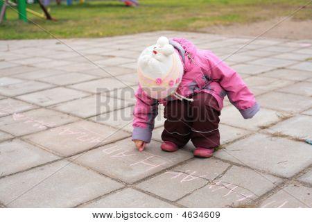 Child Writes On Road