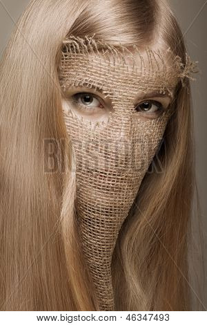 beautiful blond woman with gunny mask on her face