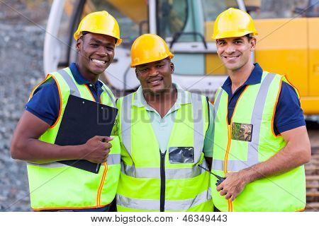 portrait of smiling construction workers