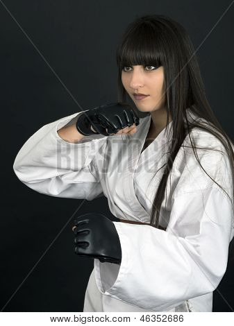 Karateka Asian Girl On Black Background Studio Shot