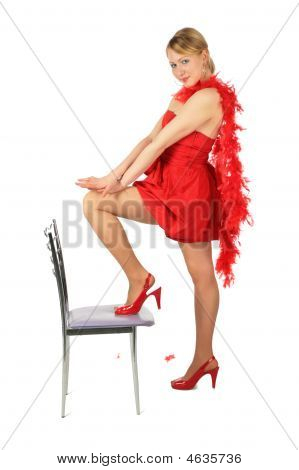 Girl In Red Dress And Shoes Puts Leg On Chair