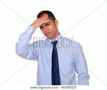 Latin Man With Headache Holding His Forehead
