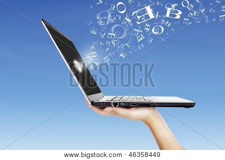 Alphabet Letters Flying From Laptop Screen Outdoor