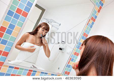 Dental care.Woman cleans a teeth