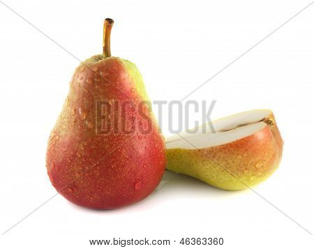 Ripe red pear with half on white (water drop)