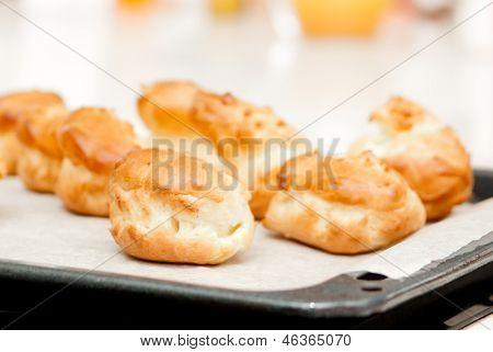 delisious profiteroles on the baking tray