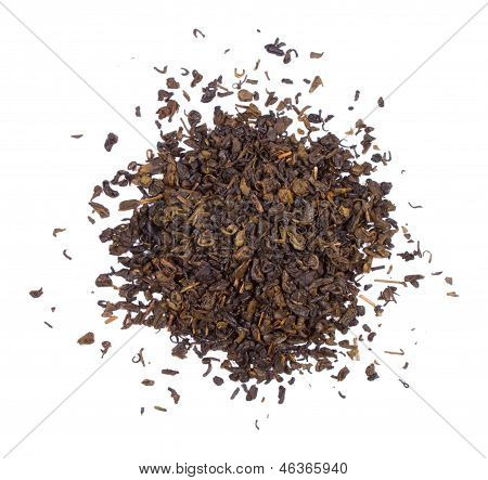 The pile of the dry green tea leaves.