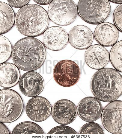 One penny coin among other coins.