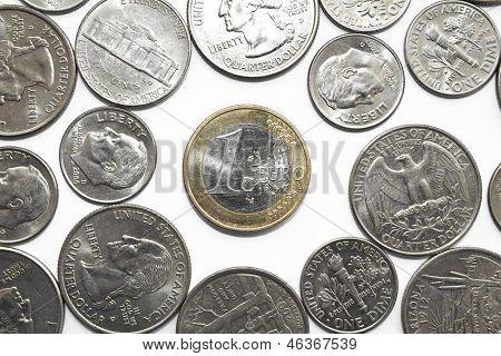 One Euro coin among dollar coins.