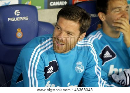 BARCELONA - MAY, 11: Xabi Alonso of Real Madrid on the bench  during the Spanish League match between Espanyol and Real Madrid at the Estadi Cornella on May 11, 2013 in Barcelona, Spain