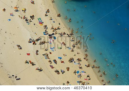 people at shipwreck beach at Zakynthos island