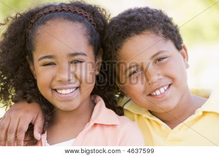 Brother And Sister Outdoors Smiling