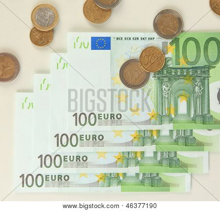 Euro banknotes and euro cents isolated on white