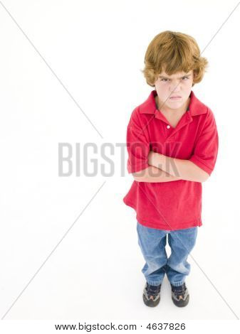 Young Boy With Arms Crossed Angry