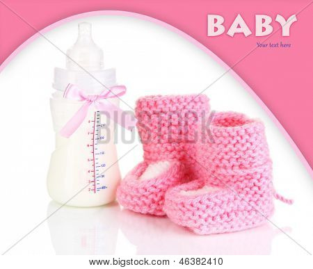 Bottle for milk formula with booties isolated on white