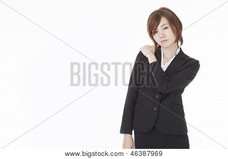 Businesswoman Suffering From Shoulder Stiffness