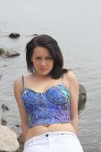 picture of halter-top  - Pretty teenage girl in a halter top - JPG