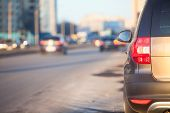 stock photo of skid  - Passenger car parking at the curb urban roads - JPG