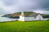 stock photo of ireland  - Small lighthouse on the coast of Ireland - JPG