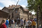 OSWIECIM - MAY 26: Tourists at the entrance of the concentration camp in Oswiecim, Poland on May 26,