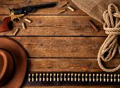 stock photo of cartridge  - Western accessories on wooden table  - JPG