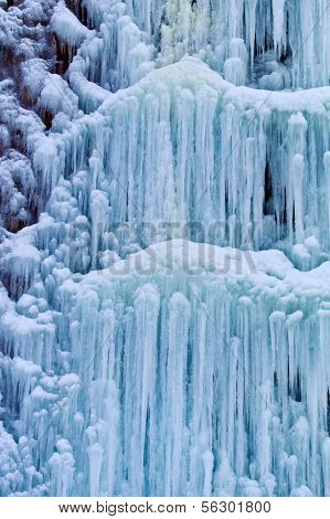 a frozen from the cold waterfall. icy waterfall in winter.