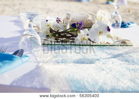 table centerpiece with flowers on natural background, dinner setup in outdoor restaurant