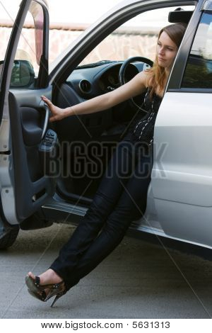 Young Woman In A Car.